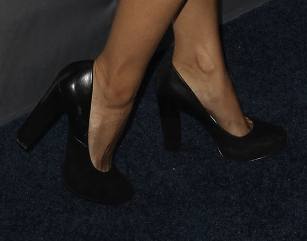 Nadine Velazquez's pretty feet in black thick-heeled pumps