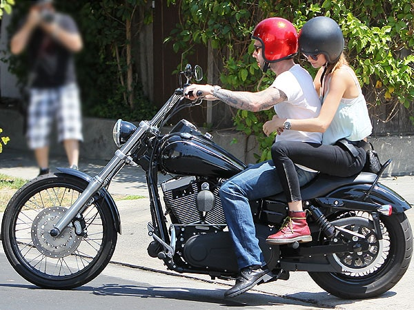 Adam Levine and Behati Prinsloo riding on a motorcycle after having lunch at Mustard Seed Cafe in Los Feliz, California, on August 7, 2012