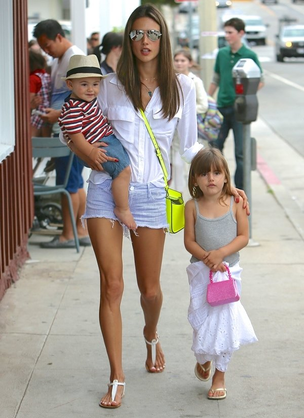 Alessandra Ambrosio and kids leaving Calypso at the Brentwood Country Mart in Los Angeles on July 2, 2013