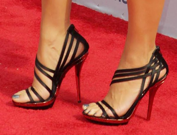 Amber Rose shows off her feet in black stiletto sandals