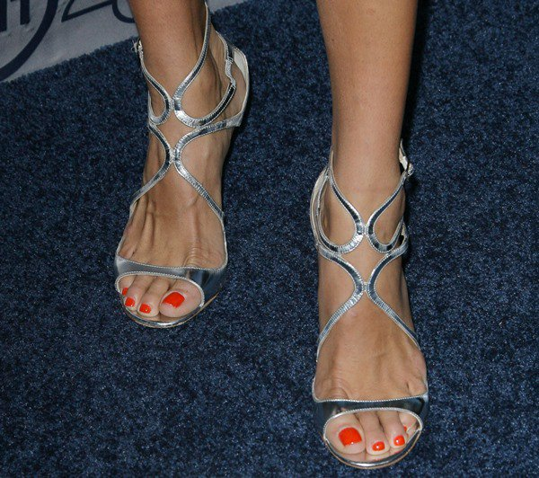 "Angie Harmon's pedicured toes in metallic silver Jimmy Choo ""Lang"" sandals"