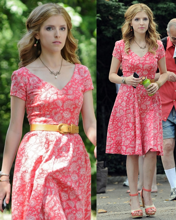 Anna Kendrick sported a pink printed dress that was cinched on the waist with a tan belt