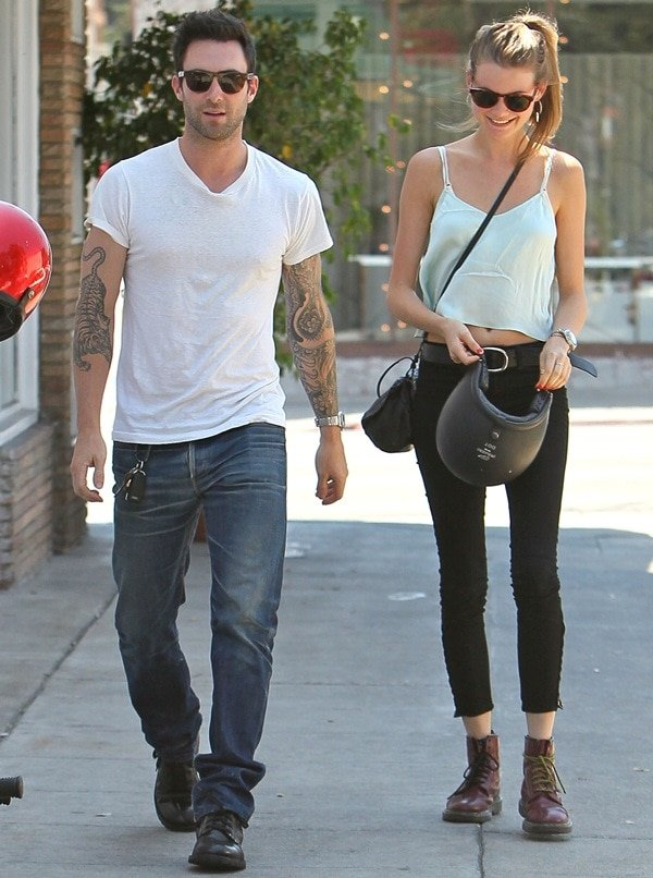 Adam Levine and Behati Prinsloo return to their parked motorcycle after having lunch at Mustard Seed Cafe in Los Feliz on August 7, 2012