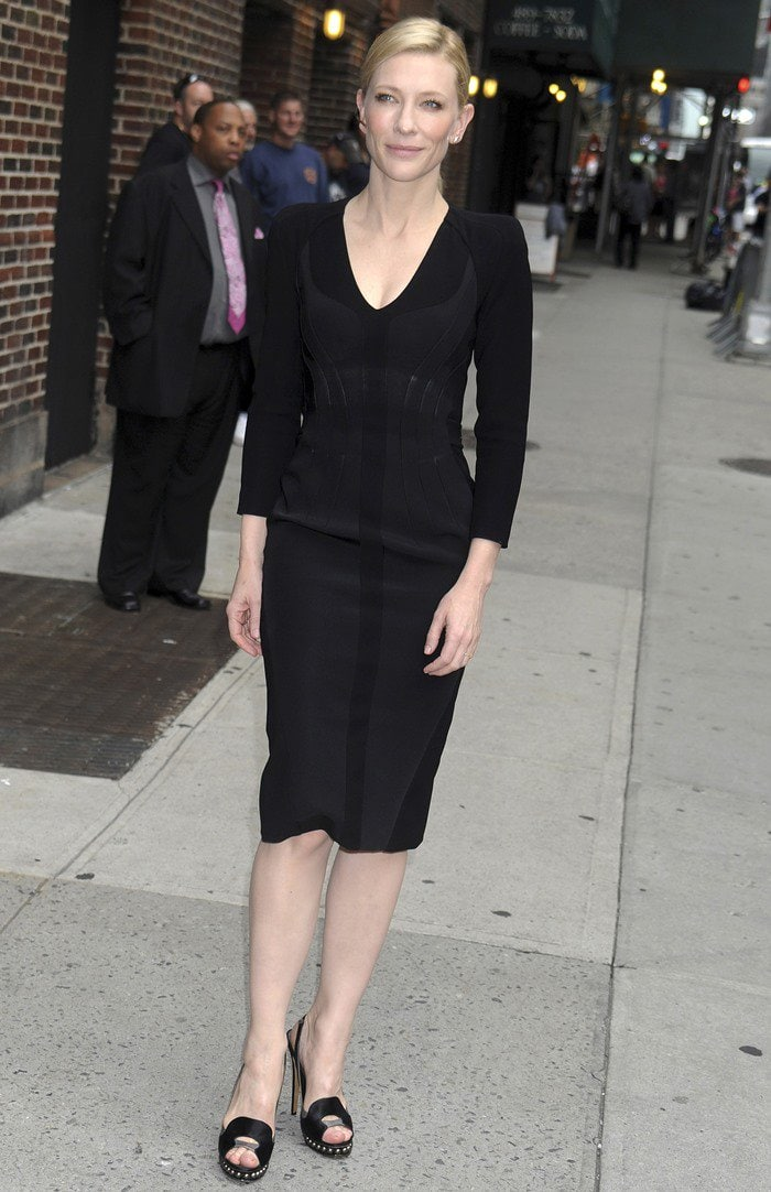 Cate Blanchett flaunts her legs in a black dress from Altuzarra's Fall 2013 collection