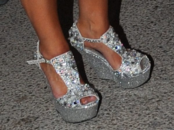 Chelsee Healey wearing studded silver wedge sandals