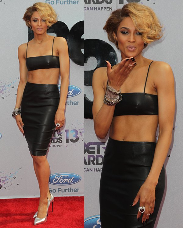 Ciara was sizzling hot in a Saint Laurent ensemble — a black leather bralet and a matching leather skirt with contrast silver pointed-toe pumps