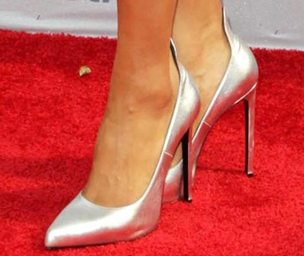 Ciara wearing contrast silver pointed-toe pumps
