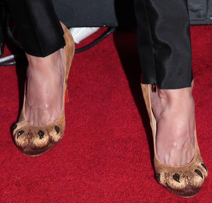 "Phillipe Blond wearing Christian Louboutin's ""Alex"" lion paw pumps"