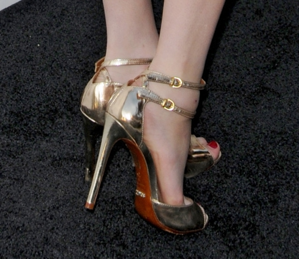 Emma Roberts wearing Schutz sandals featuring a gorgeous rose gold tone in mirrored leather