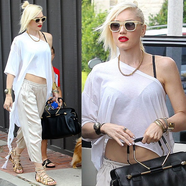 """Gwen Stefani rockin' her version of a white t-shirt, khakis, and sandals, putting her unique personal touch to it via striped wayfarers, a to-die-for Viktor & Rolf """"Bombette"""" handbag, and her signature red lips"""