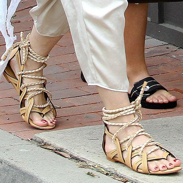 Gwen Stefani's tan lace-up flat sandals up close