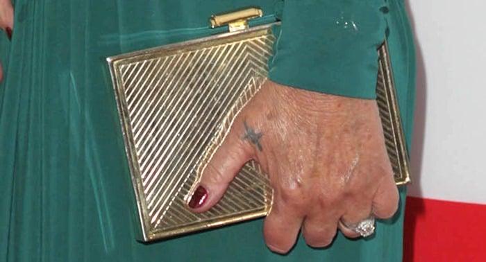 Helen Mirren carrying a stunning clutch handbag