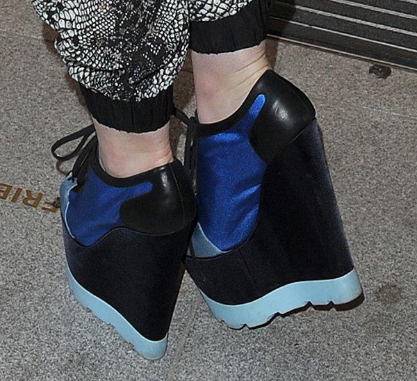 Iggy Azalea rocksblack-and-blue wedge trainers