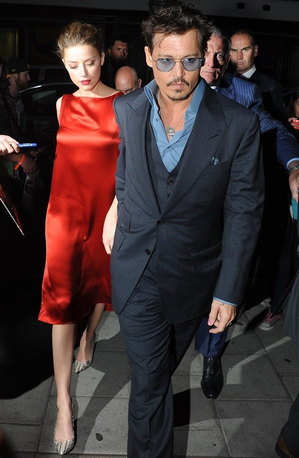 Amber Heard wearing a red silk shift with snake-print pumps for her date with Johnny Depp