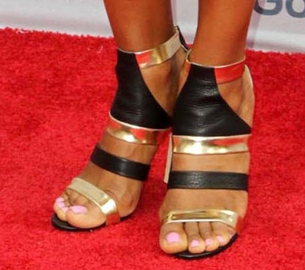 Laila Ali shows off her feet in Jimmy Choo heels