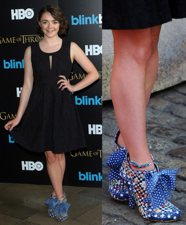Maisie Williams matching her sexy black dress with a pair of blue polka-dot bow shoes