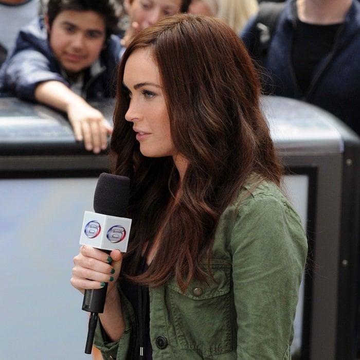 Megan Fox filming scenes for 'Teenage Mutant Ninja Turtles' while clad in the Rag & Bone Newbury boots in Manhattan, New York City, on July 22, 2013