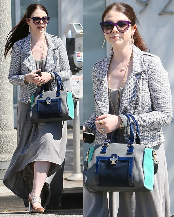 Michelle Trachtenberg sported a flowing hi-low maxi dress from Lanston paired with a matching gray blazer