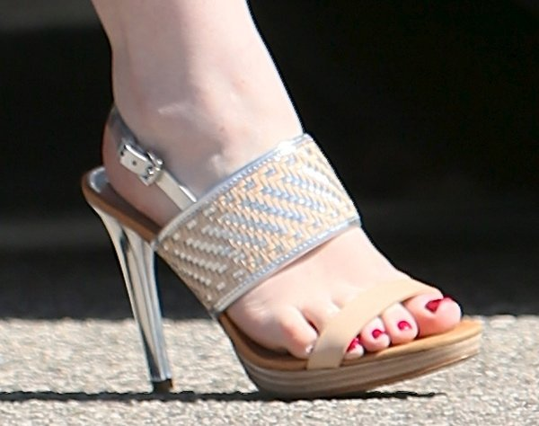 Michelle Trachtenberg wearing a pair of edgy heels with silver metallic accents
