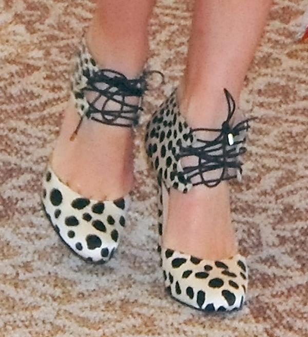 Miranda Kerr wearing leopard-printed crepe satin pumps