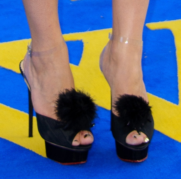 Ophelia Lovibond shows off her sexy feet in black sandals