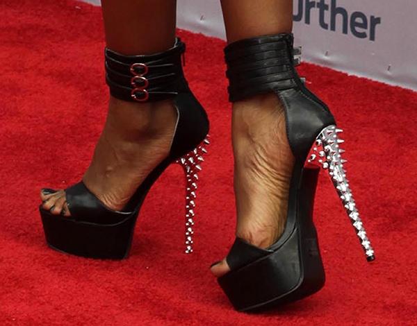 Porscha Coleman shows off her feet in black platform heels