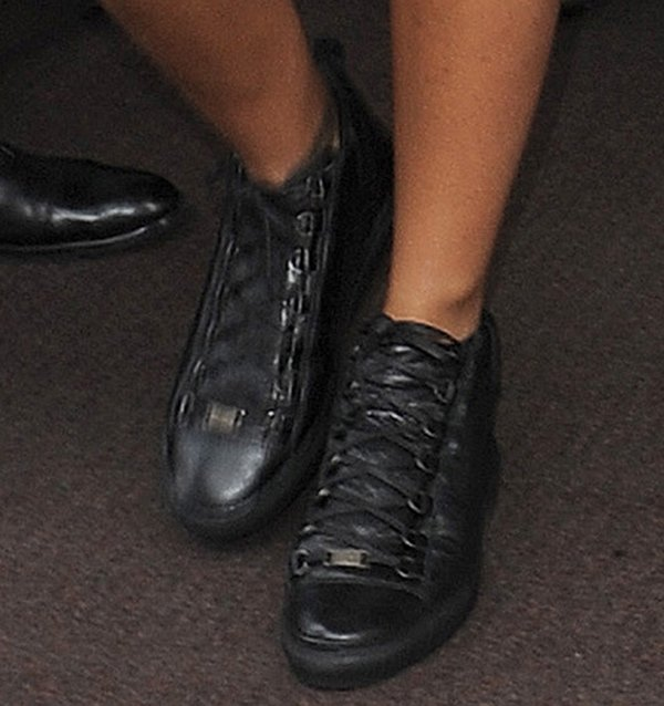 Rihanna rocks black high trainers