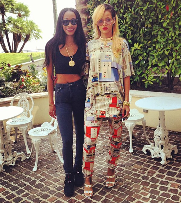 Rihanna, posing with Melissa Forde, in matching shirt and trousers from the Givenchy Men's Spring 2013 collection on July 13, 2013