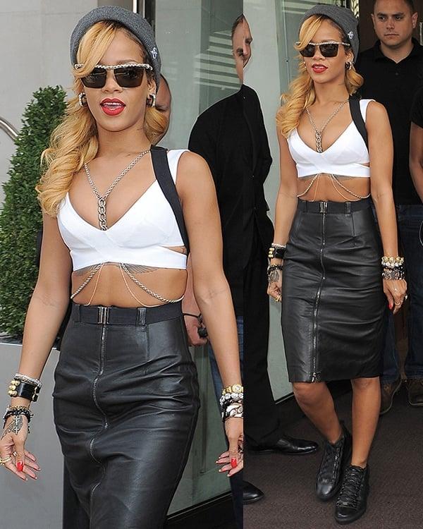 Rihanna flaunts her legs in a black leather suspender skirt by Gareth Pugh