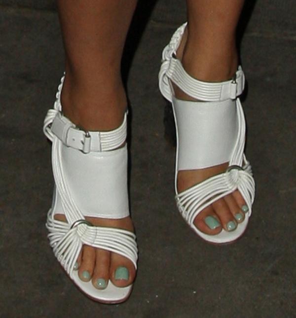 Rita Ora shows off her pretty feet in white sandals