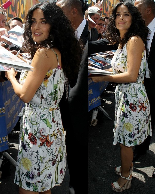 Salma Hayek greeted fans and signed autographs while dressed in a pretty floral number with matching wedge sandals