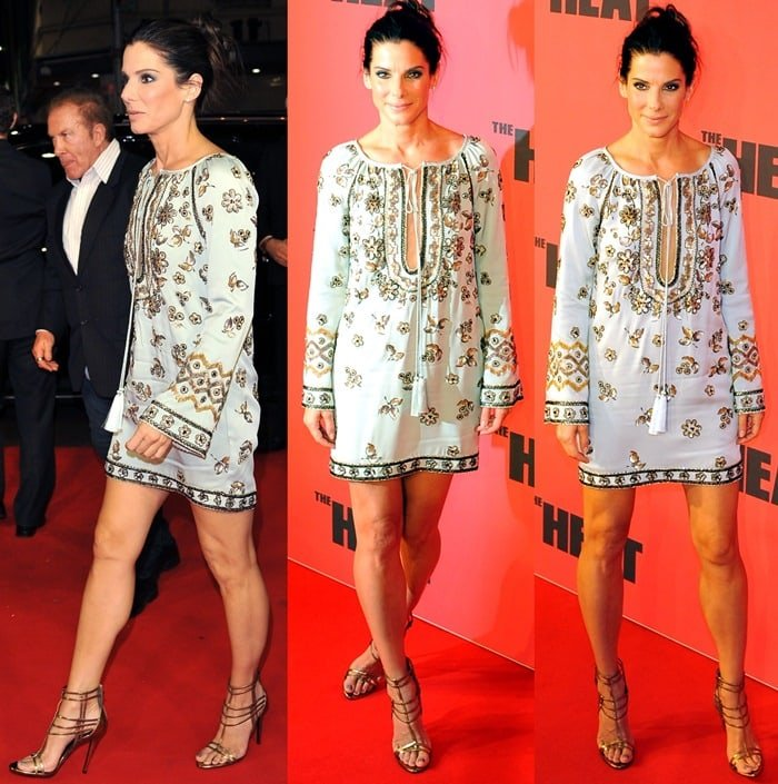 Sandra Bullock flaunts her sexy legs ina short gold-embellished tunic