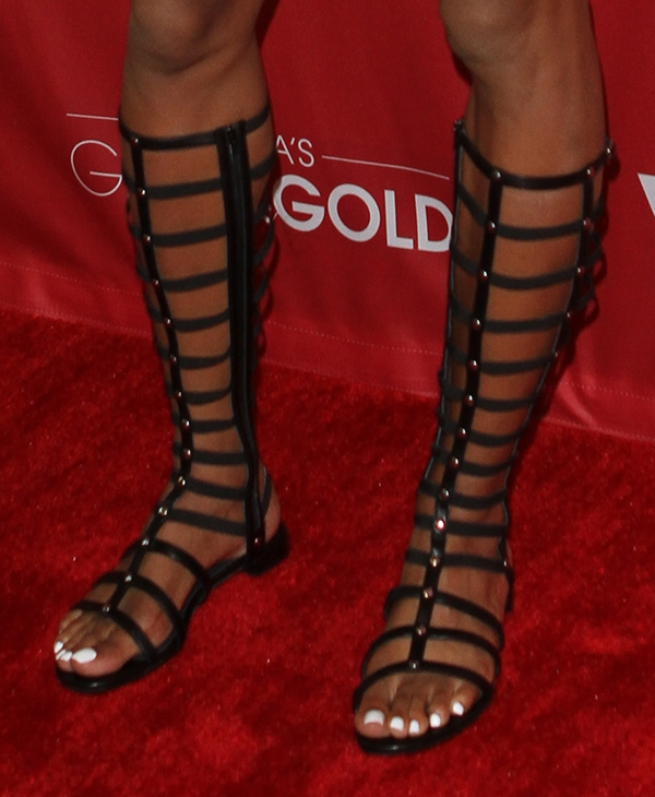 Sanya Richards-Ross wearing knee-high gladiator sandals