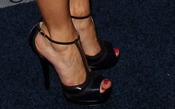 Sasha Alexander shows off her feet in Fendi laser-cut t-strap sandals