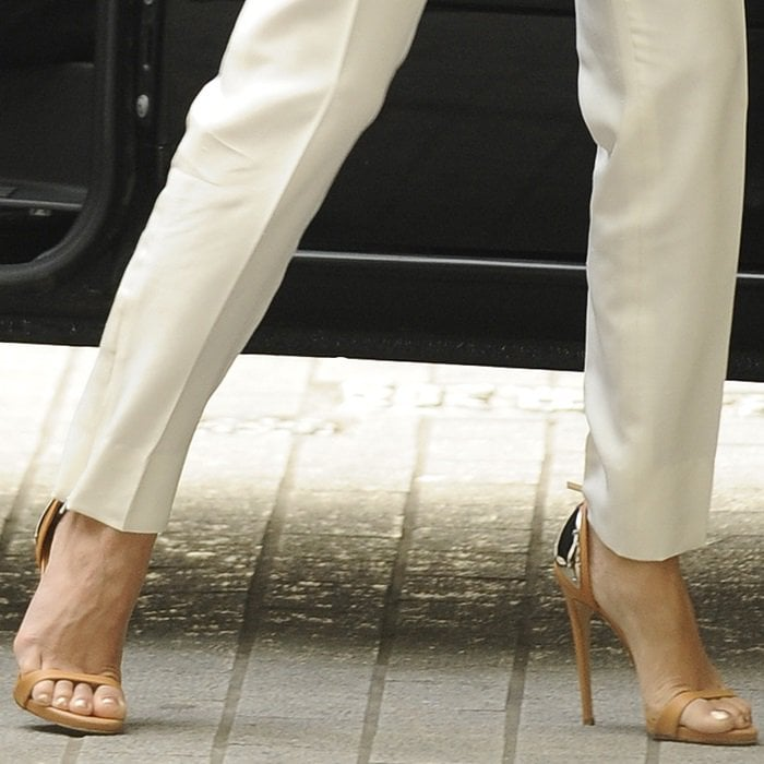 Vanessa Hudgens giving a glimpse of the plated heels on her sandals as she steps out of a van