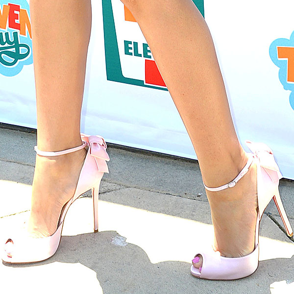 Closeups of Zendaya Coleman's pink satin back-bow Louboutins