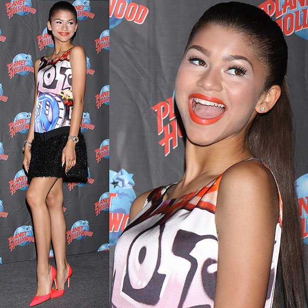 """Zendaya Coleman promoting her new song, """"Replay,"""" with a handprint ceremony at Planet Hollywood Times Square in New York City on July 15, 2013"""