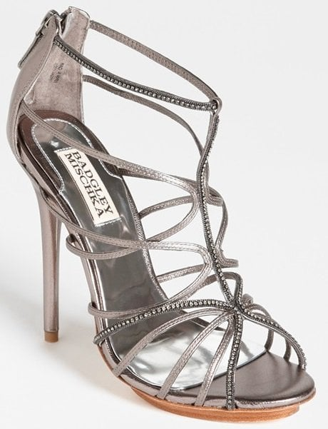 Diminutive crystals highlight the ultraslim curves of a scintillating cage sandal, balanced by a wrapped heel and barely there platform