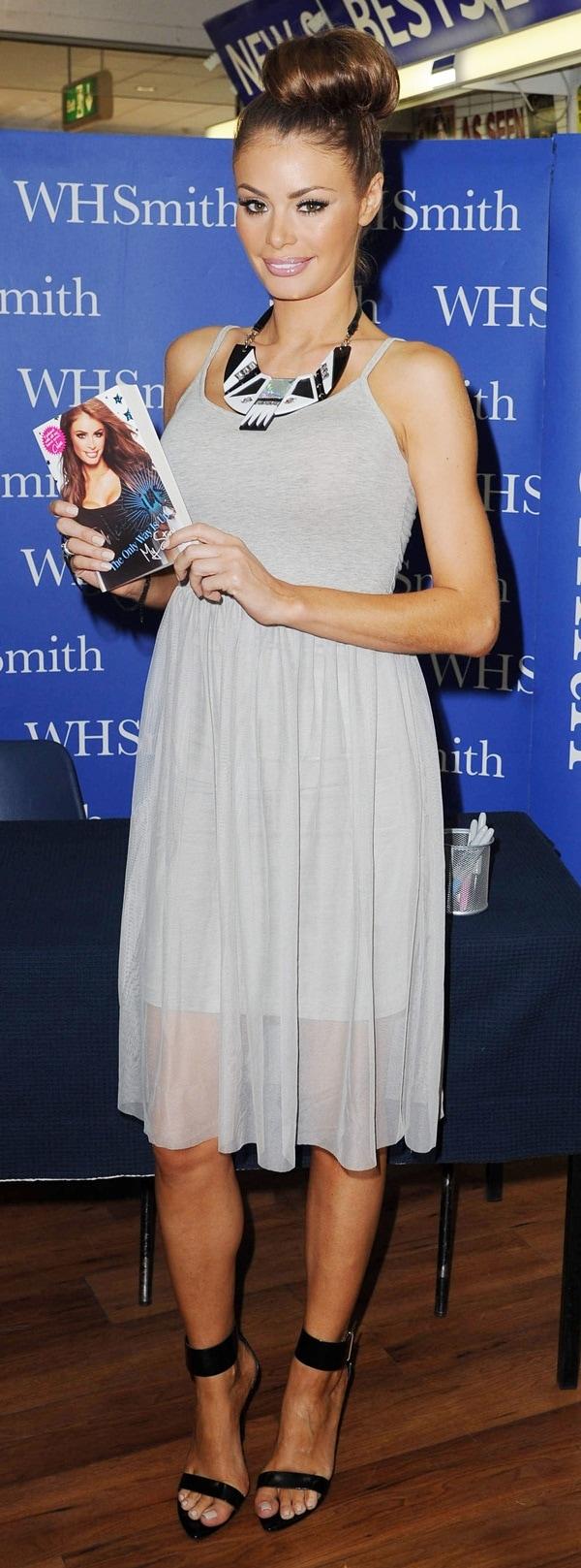 Chloe Sims with a high hair bun in a hot summer dress