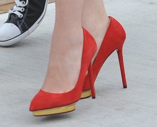 Emilia Clarke shows off her feet in red Charlotte Olympia Debbie pumps
