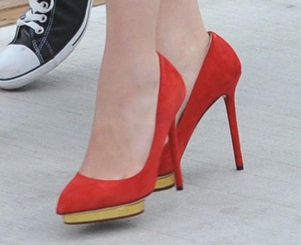 Emilia Clarke shows off her feet inred Charlotte Olympia Debbie pumps