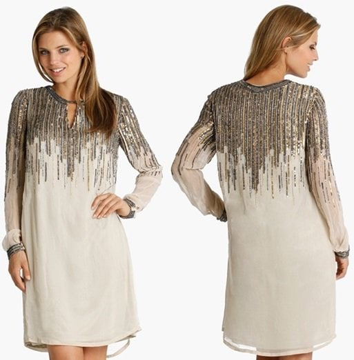 Metallic sequins diffuse down the keyhole-front bodice of a simply chic shift with embellished cuffs polishing the long sleeves