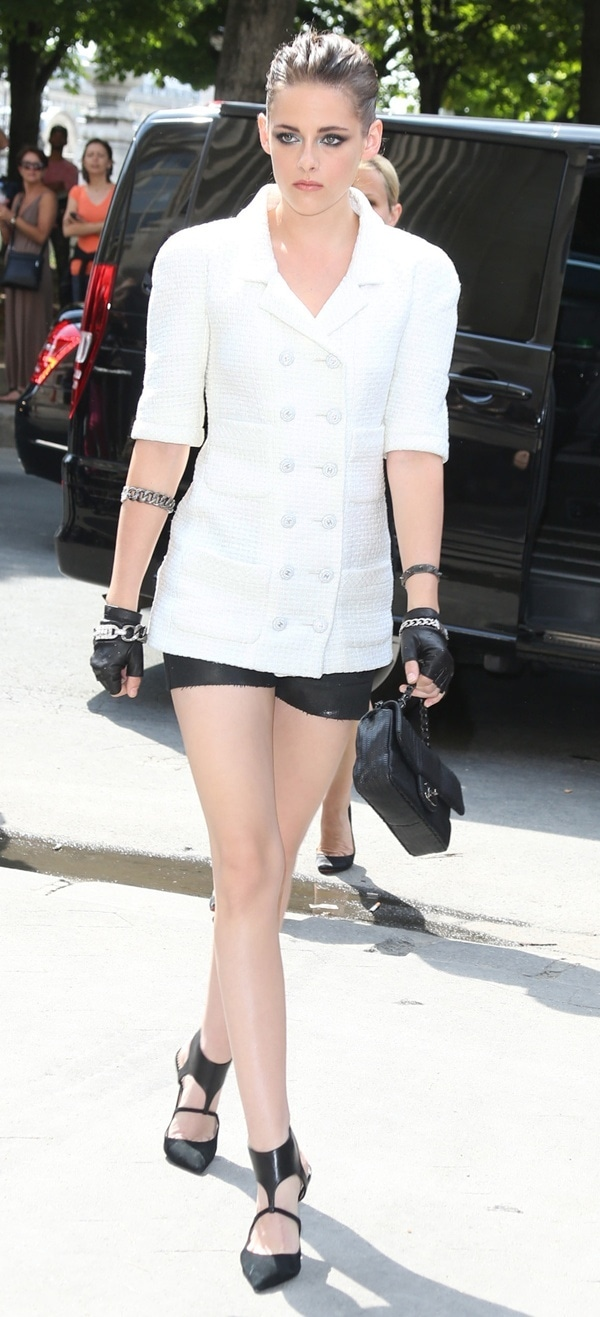 Kristen Stewart rocking a white Chanel jacket with tiny black leather shorts