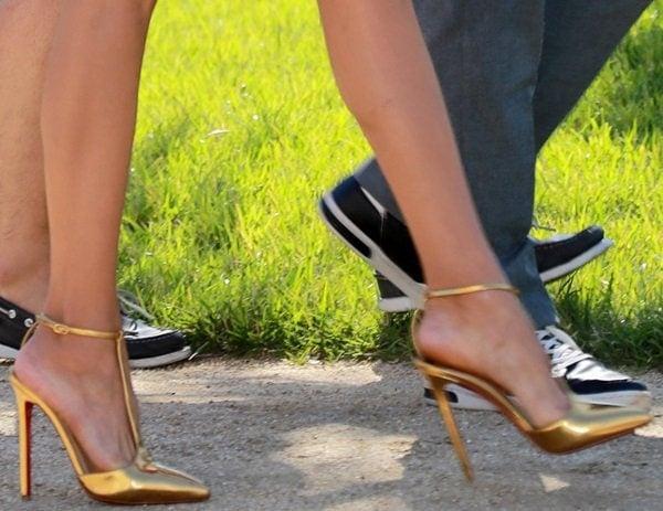 Nina Dobrev's gold sky-high heels