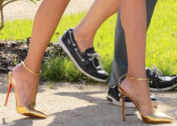 Nina Dobrev flaunts her legs ingold sky-high pointy T-strap heels