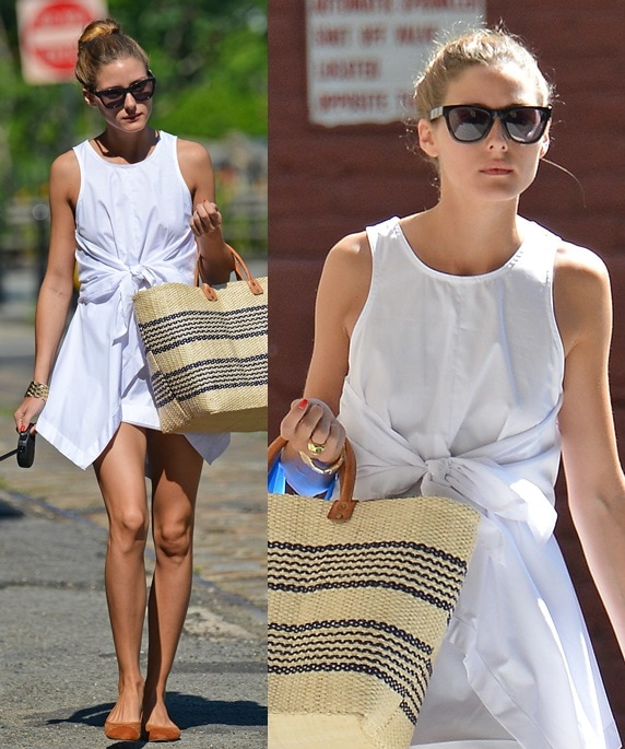 Olivia Palermo looking summer chic in a white dress and easy flats in New York City on July 16, 2013