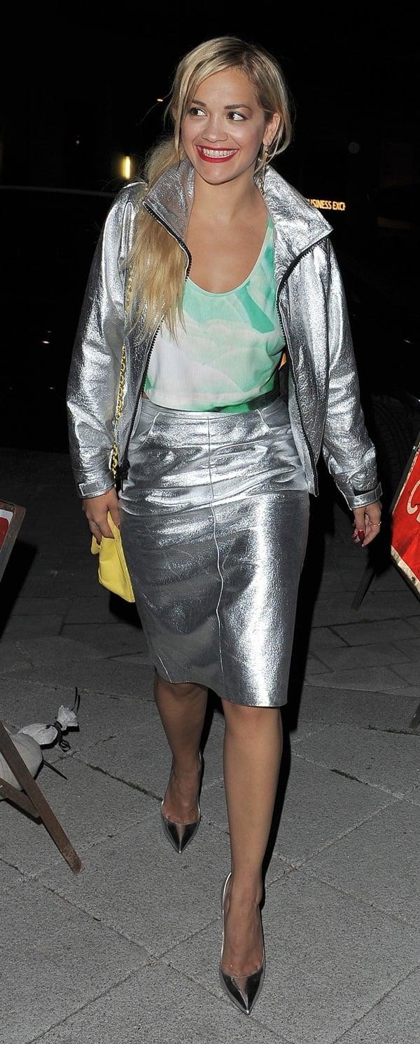Rita Ora wearing a DKNY metallic silver skirt with a matching jacket