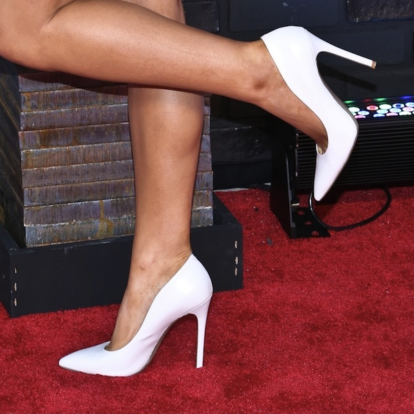 Ariana Grande wearing white pointy-toe pumps