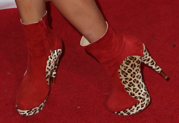 Bai Ling wearing red suede booties with a leopard-print design