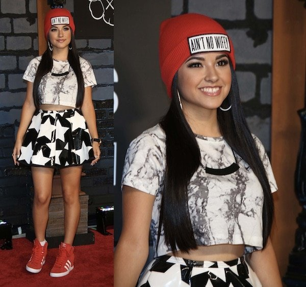 Becky G looked relaxed and ready to party in Adidas sneakers paired with a cute star-print skirt and a casual top